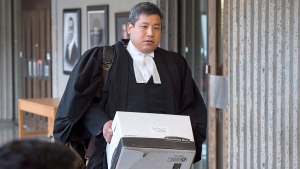 Eugene Tan, lawyer for William Sandeson, arrives for the start of his trial at Nova Scotia Supreme Court in Halifax on Thursday, April 20, 2017. Sandeson is charged with first-degree murder in the death of Taylor Samson, a fellow Dalhousie University student, who was last seen on Aug. 15, 2015 and whose body has not been found. (THE CANADIAN PRESS/Andrew Vaughan)