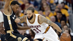 Cleveland Cavaliers' Deron Williams (31) fouls Toronto Raptors' Kyle Lowry (7) during the first half in Game 2 of a second-round NBA basketball playoff series, Wednesday, May 3, 2017, in Cleveland. (AP Photo / Tony Dejak)