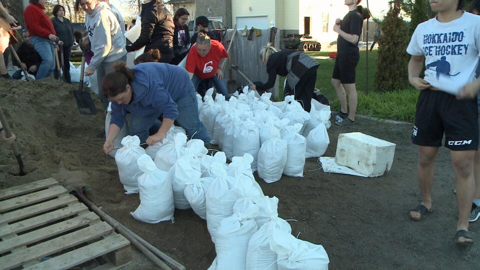 Volunteers help fill sandbags to help flooded homeowners in Rockland, Ontario. May 3, 2017