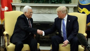 U.S. President Donald Trump shakes hands with with Palestinian President Mahmoud Abbas during their meeting in the Oval Office of the White House, Wednesday, May 3, 2017, in Washington. (AP Photo/Evan Vucci)