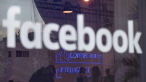 Facebook sign (TOBIAS SCHWARZ / AFP)