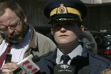 "RCMP Const. Kathy Brousseau explains what's known as the ""grandson"" scam to reporters. (Mar. 24, 2009)"