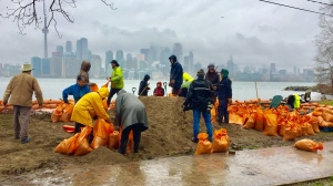Dozens of Toronto Island residents are setting up sandbags as barricades to protect the island's infrastructure. (Travis Dhanraj/CP24)