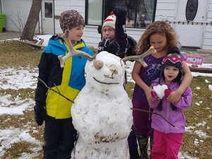 """Saskatchewan style Olaf made in Rosetown on April 27, 2017 after the snowfall. Made by Kara, Logan, Lucy, Sarah and Karen. Great fun!"" (Karen Cavanagh)"