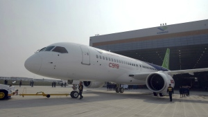 Workers roll out the first C919 jet aircraft manufactured at the state-owned Commercial Aircraft Corp. of China Ltd. (COMAC) in Shanghai on Nov. 2, 2015. (Chinatopix)
