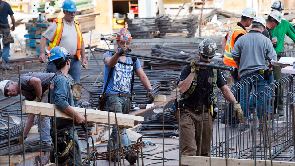 Workers are busy on a construction site in downtown Montreal, Friday, Oct. 11, 2013. (Ryan Remiorz / THE CANADIAN PRESS)