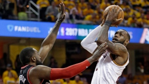 Cleveland Cavaliers' LeBron James, right, drives to the basket against Toronto Raptors' Patrick Patterson (54) in the first half in Game 1 of a second-round NBA basketball playoff series,, Monday, May 1, 2017, in Cleveland. (AP Photo/Tony Dejak)