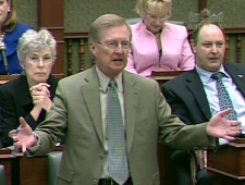 Interim PC Leader Bob Runciman stands during question period at Queen's Park in Toronto, Wednesday, March 25, 2009.
