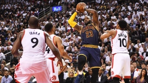 Cleveland Cavaliers' LeBron James looks to pass as Toronto Raptors forward Serge Ibaka (9) Raptors guard Norman Powell (24) and Raptors guard DeMar DeRozan (10) defend during the second half of game three of an NBA playoff series basketball game in Toronto on Friday, May 5, 2017. THE CANADIAN PRESS/Frank Gunn