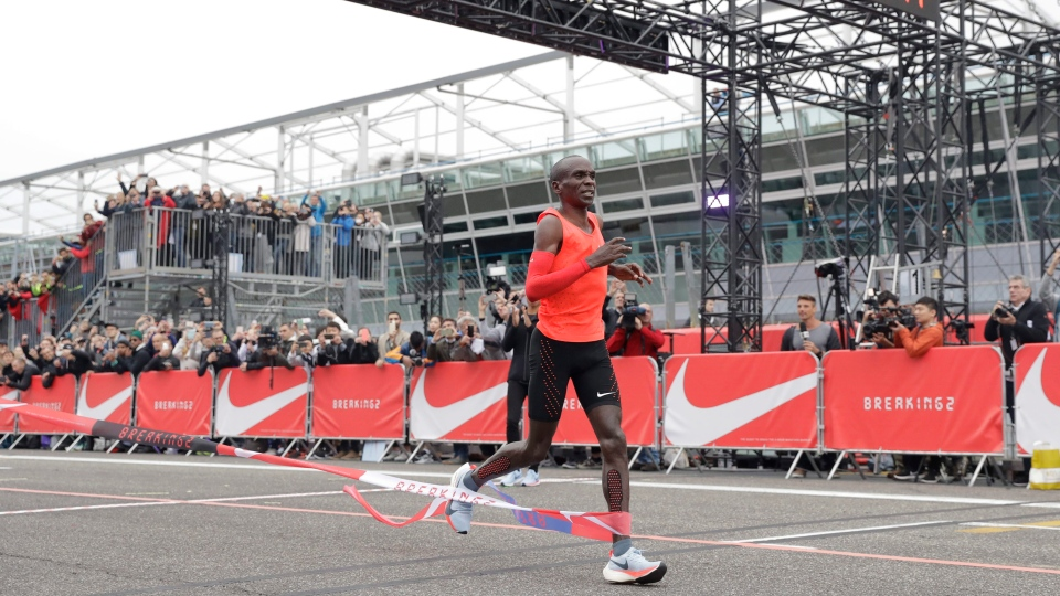 Olympic marathon champion Eliud Kipchoge crosses the finish line of a marathon race at the Monza Formula One racetrack, Italy, Saturday, May 6, 2017. (AP / Luca Bruno)