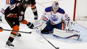 Anaheim Ducks right wing Corey Perry, left, scores the game winning goal past Edmonton Oilers goalie Cam Talbot during the fifth period in overtime in Game 5 of a second-round NHL hockey Stanley Cup playoff series in Anaheim, Calif., Friday, May 5, 2017. (AP / Chris Carlson)