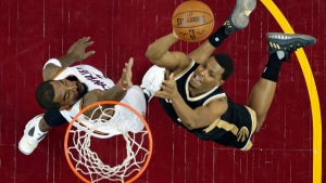 Toronto Raptors' Kyle Lowry, right, drives to the basket against Cleveland Cavaliers' J.R. Smith during the second half in Game 2 of a second-round NBA basketball playoff series, Wednesday, May 3, 2017, in Cleveland. The Cavaliers won 125-103. (AP Photo/Tony Dejak)