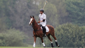 In this Saturday, May 6, 2017 photo, Prince Harry takes part in the annual Audi Polo Challenge at Coworth Park polo club in Ascot, England. (Steve Parsons/PA via AP)