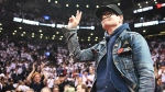 The Tragically Hip lead singer Gord Downie salutes fans during the first half of game three of an NBA playoff series basketball game between the Toronto Raptors and Cleveland Cavaliers in Toronto on Friday, May 5, 2017. THE CANADIAN PRESS/Frank Gunn