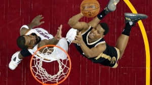 Toronto Raptors' Kyle Lowry, right, drives to the basket against Cleveland Cavaliers' J.R. Smith during the second half in Game 2 of a second-round NBA basketball playoff series in Cleveland on May 3, 2017. THE CANADIAN PRESS/AP, Tony Dejak