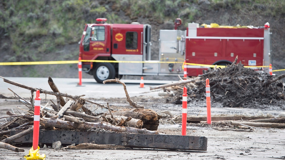 Flood debris is seen on the road in Cache Creek, B.C., Saturday, May 6, 2017. The small B.C. community was hit this week with flooding from melting snow pack. (THE CANADIAN PRESS/Jonathan Hayward)