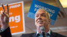 NDP Leader John Horgan gestures to indicate two days until election day while addressing supporters during a campaign stop in Vancouver, B.C., on Sunday May 7, 2017. A provincial election will be held on Tuesday. (THE CANADIAN PRESS/Darryl Dyck)