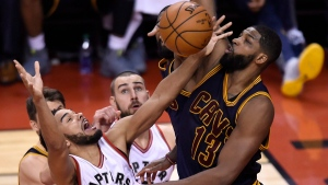 Cleveland Cavaliers center Tristan Thompson (13) fouls Toronto Raptors guard Cory Joseph (6) under the basket during second half NBA playoff basketball action in Toronto on Sunday, May 7, 2017. (THE CANADIAN PRESS/Nathan Denette)