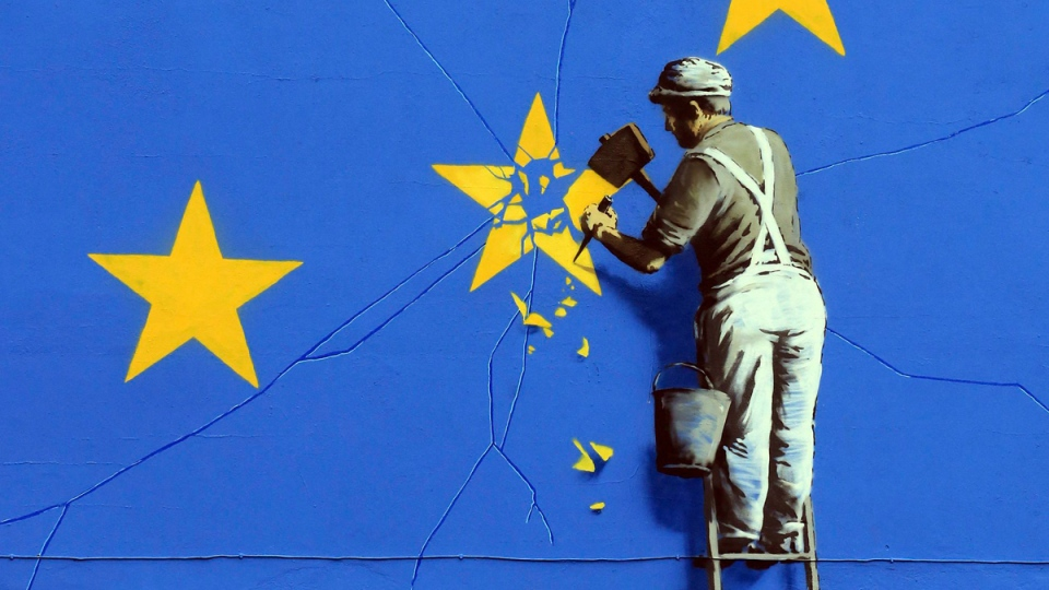 A view of a mural by artist Banksy of a workman removing a star from the EU flag, in Dover England on May 8, 2017. (Gareth Fuller/via AP)