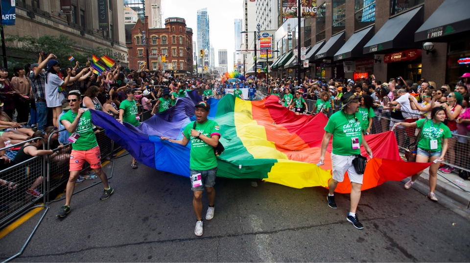 People take part in the annual Pride Parade in Toronto on Sunday, July 3, 2016. (THE CANADIAN PRESS/Nathan Denette)