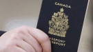 A passenger holds a Canadian passport before boarding a flight in Ottawa on Jan 23, 2007. (Tom Hanson/The Canadian Press)