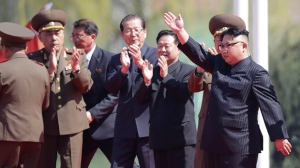 North Korean leader Kim Jong Un, right, waves during the opening ceremony of the Ryomyong residential area, a collection of more than a dozen apartment buildings in Pyongyang, North Korea on April 13, 2017. (AP / Wong Maye-E)