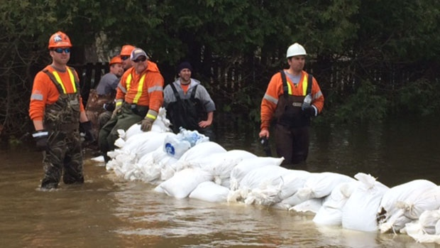 Workers can be seen near sandbags in Minden, Ont. on Monday, May 8, 2017. (Aileen Doyle/ CTV Barrie)