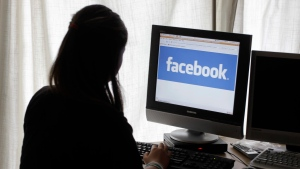 In this Monday, June 4, 2012, file photo, a woman looks at Facebook on her computer in Palo Alto, Calif. (AP / Paul Sakuma)