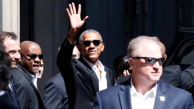 United States former President Barack Obama waves as he leaves his hotel, in Milan, Monday, May 8, 2017. (Antonio Calanni/AP)