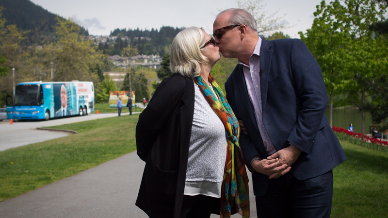 B.C. NDP Leader John Horgan and his wife Ellie kiss while waiting outside a polling station in Coqutilam, B.C. May 9, 2017. (THE CANADIAN PRESS/Darryl Dyck)