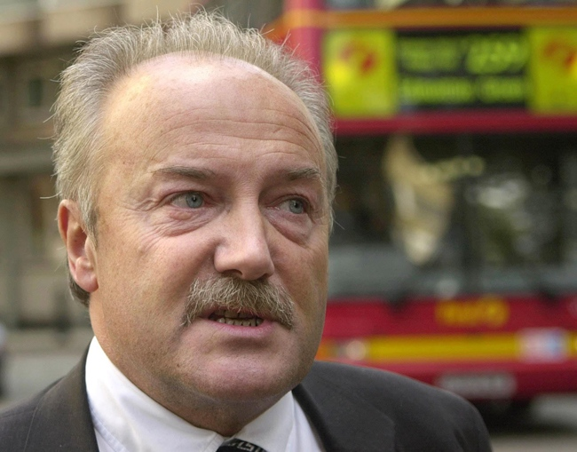 British MP George Galloway leaves Swinton House in central London, Thursday Oct. 23, 2003. (AP / Max Nash)