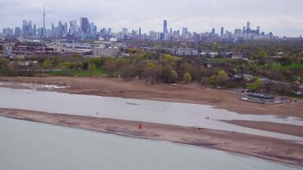 A large inland lake has formed on Woodbine Beach due to Lake Ontario's rising water levels and relentless rain. (CP24)