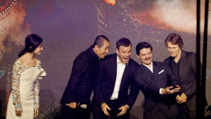In this Dec. 6, 2016 file photo, actors from right, Willem Dafoe, Pedro Pascal, Matt Damon, movie director Zhang Yimou and actress Jing Tian pose for a selfie on stage upon arrival for a news conference for the movie 'The Great Wall' at a hotel in Beijing. (AP Photo/Andy Wong, File)