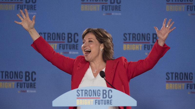 B.C. Liberal leader Christy Clark waves to the crowd at party headquarters in Vancouver following Tuesday's election. (THE CANADIAN PRESS/Jonathan Hayward)