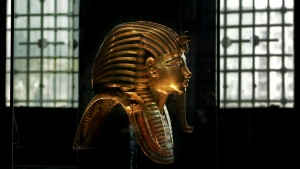 In this Oct. 30, 2013 photo, the solid gold mask of King Tutankhamun is seen in its glass case, in the Egyptian Museum near Tahrir Square in Cairo, Egypt. (Nariman El-Mofty/AP Photo)