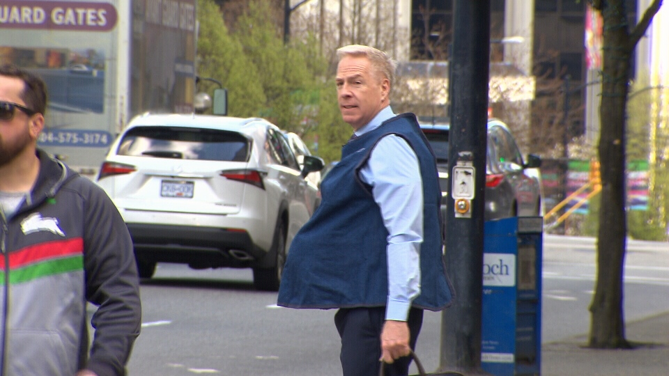 """Ross McLaughlin walks around downtown Vancouver wearing the """"empathy"""" belly. (CTV)"""