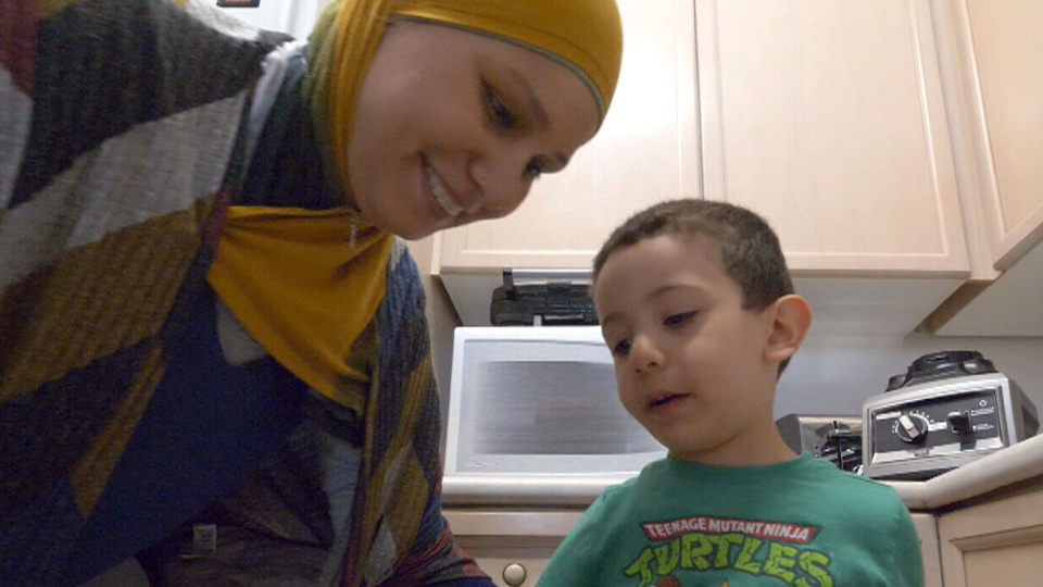 Abeer Salim says her treatments and chemotherapy often leave her so drained that she cannot get out of bed, let alone do the one thing the brightens her day the most -- play with her young son.