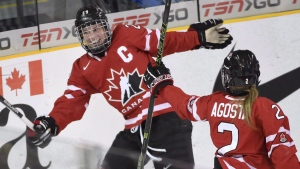 Canada's Marie-Philip Poulin (29) celebrates her goal against Finland with teammate Meghan Agosta (2) during first period action at the women's world hockey championships in Kamloops, B.C. on Thursday, March 31, 2016. (Ryan Remiorz / THE CANADIAN PRESS)