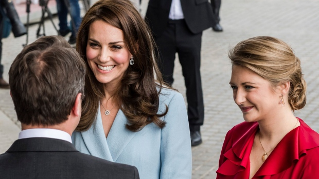 The Duchess of Cambridge and Belgian Countess and wife of Hereditary Grand-Duke of Luxembourg Stephanie de Lannoy speak with Luxembourg's Prime Minister Xavier Bettel, left, as they arrive at the Museum of Modern Art during the Celebration of the 150th anniversary of the 1867 Treaty of London in Luxembourg. (AP Photo / Geert Vanden Wijngaert)