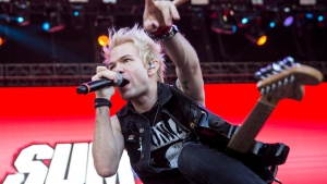 Deryck Whibley of the Canadian rock band Sum 41 performs during the concert at the 24th Sziget (Island) Festival on Shipyard Island, Northern Budapest, Hungary, Sunday, Aug. 14, 2016. (THE CANADIAN PRESS/AP, Janos Marjai, MTI)