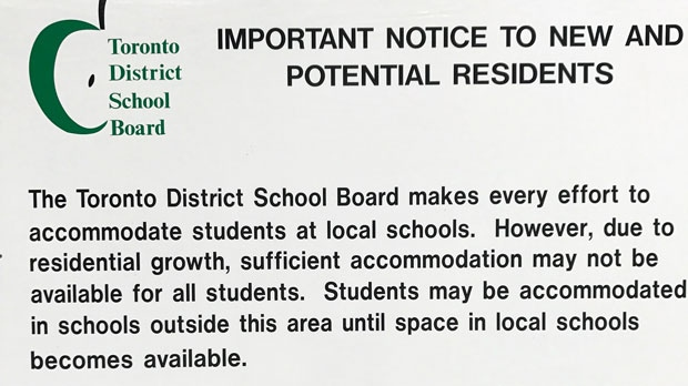 The Toronto District School Board has placed signs around Leslieville warning residents of a school shortage in the area.