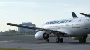 File - WestJet said the passengers were rebooked on another flight that departed about 2.5 hours later.