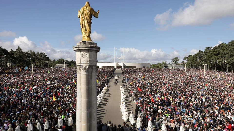 The statue of Our Lady of Fatima is carried in a procession for a Mass celebrated by Pope Francis where he will canonize shepherd children Jacinta and Francisco Marto at the Sanctuary of Our Lady of Fatima, Saturday, Friday, May 13, 2017, in Fatima, Portugal. (Paulo Novais/Pool Photo via AP)