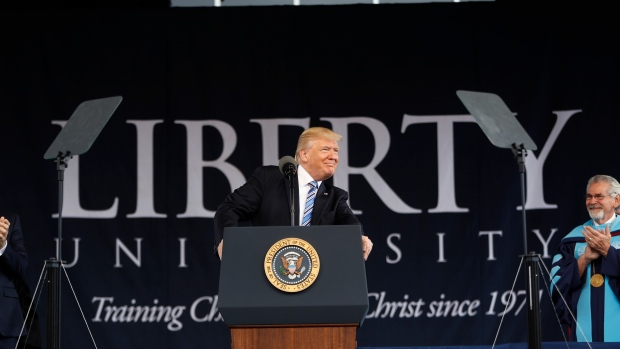 Trump urges graduates to learn 'lesson from his outsider status'