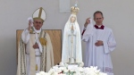 Pope Francis, left, and Master of Pontifical Liturgical Celebrations Guido Marini wave white handkerchiefs as the statue of Our Lady of Fatima is shoulder-carried at the end of a Mass celebrated by Pope Francis where he will canonize shepherd children Jacinta and Francisco Marto, at the Sanctuary of Our Lady of Fatima Saturday, May 13, 2017, in Fatima, Portugal. (AP Photo/Armando Franca)