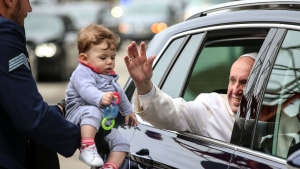 Pope Francis blesses a child upon his departure from Monte Real Air Base, in Leiria, Portugal, Saturday, May 13, 2017. (Paulo Cunha/Pool Photo via AP)