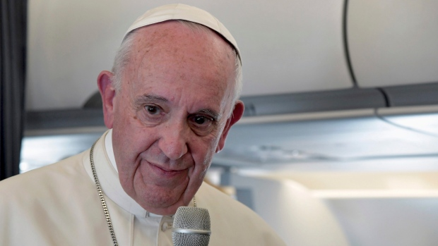 Pope Francis addresses journalists during the traditional press conference on his flight back to Rome, following a two-day visit at Fatima, Portugal, Saturday, May 13, 2017. (Tiziana Fabi/Pool Photo via AP)