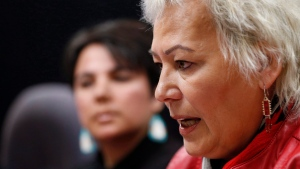 In this file photo, Angie Hutchinson (left), Ka Ni Kanichihk, Family Support Coordinator and Missing and Murdered Indigenous Women and Girls (MMIWG) Coalition member listens in as Sandra Delaronde, Executive Director of the Indigenous Women's Research Institute, MMIWG Coalition co-chair expresses her concerns about the national inquiry into murdered and missing indigenous women and girls in Winnipeg, Tuesday, March 7, 2017. (John Woods / The Canadian Press)