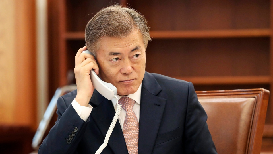 South Korean President Moon Jae in talks on phone with Japanese Prime Minister Shinzo Abe at the presidential Blue House in Seoul, South Korea, Thursday, May 11, 2017. (Yonhap via AP)