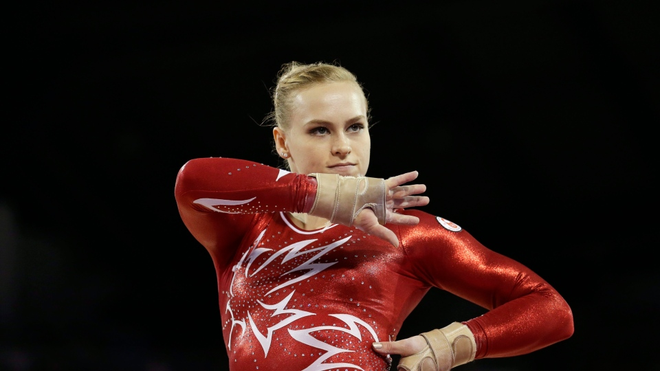 Canada's Ellie Black performs during women's artistic gymnastics floor exercise competition in the Pan Am Games in Toronto, Wednesday, July 15, 2015. (AP Photo/Gregory Bull)